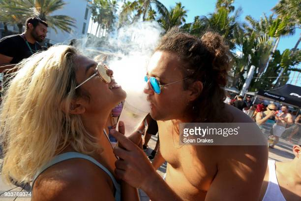 People enjoy DJ music during the launch pool party produced by 935FM Revolution Radio Miami at the Nationl Hotel on South Beach as part of Miami...