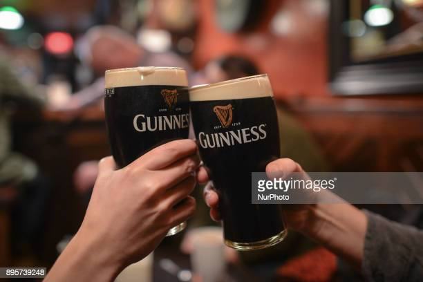 People enjoy drinking a pint of Guinness inside a Pub during the Christmas Season 2017 just a few days ahead of Christmas On Tuesday 19 December 2017...