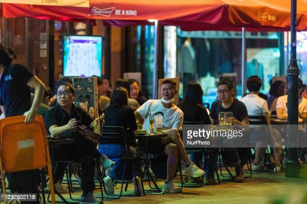 People enjoy drinks at the terrace of a restaurant in Hung Hom. On April 24, 2021 in Hong Kong, China.