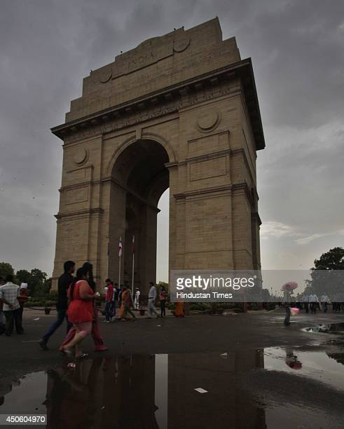 People enjoy during monsoon shower which pleasant for Delhites on June 14 2014 in New Delhi India Light rains in some parts of NCR brought much...