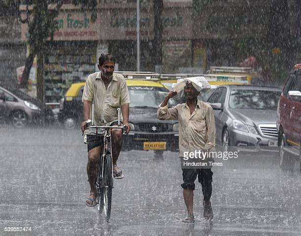 People enjoy during premonsoon showers on June 11 2016 in Mumbai India Mumbai rains have finally commenced on Saturday morning marking an end to the...