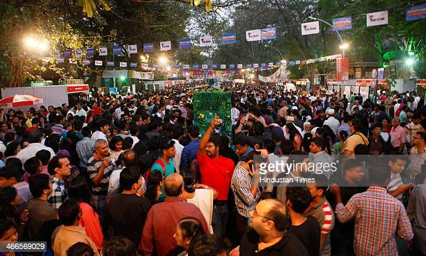 People enjoy during the Kala Ghoda Arts Festival at Cross Maidan on February 2 2013 in Mumbai India The festival will be held between February 1 and...