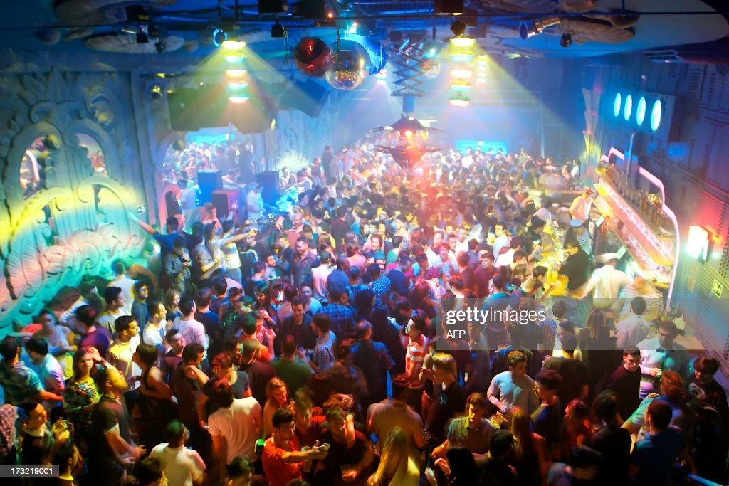 People enjoy electronic music at the nightclub 'Yatch Clube' in Sao Paulo, Brazil, on 16 June, 2013.