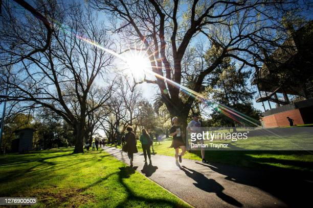 People enjoy exercise in the afternoon sun at Princes Park in Carlton on September 27 2020 in Melbourne Australia Victoria has recorded 16 new...