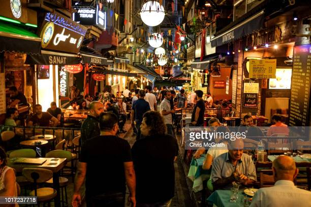 People enjoy food and drink at a popular restaurant street on August 15 2018 in Istanbul Turkey The Turkish Lira recovered to trade at 61 USD despite...