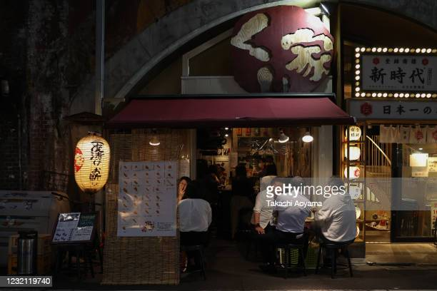 People enjoy food and drink at an izakaya bar in Shinbashi district on May 29 2020 in Tokyo Japan On May 25 Japanese government lifted the...