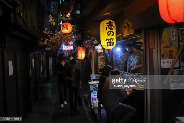 People enjoy food and drink at an izakaya bar in Shinjuku district on May 29 2020 in Tokyo Japan On May 25 Japanese government lifted the declaration...