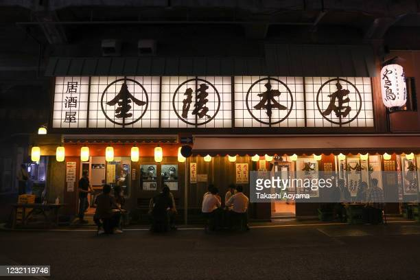 People enjoy food and drinks at an izakaya bar in Shinbashi district on May 29 2020 in Tokyo Japan On May 25 Japanese government lifted the...