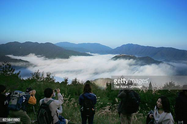 People enjoy he Takeda Castle ruins in the sea of clouds on November 5 2016 in Asago Hyogo Japan From this year the Asago city chamber of commerce...
