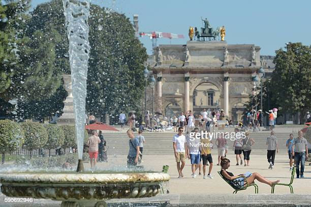 People enjoy in the Tuileries Garden near the Arc de Triomphe du Carrousel as very hot weather continues in Paris and this will remain for the next...