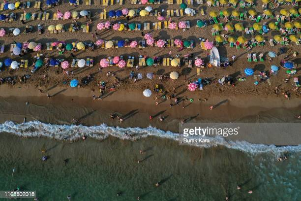 People enjoy Incekum beach on August 18 2019 in Alanya Turkey Turkey's resort towns saw a 100 percent occupancy rate with the Eid alAdha holiday...
