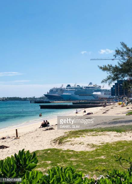 People enjoy Junkanoo beach a short distance from cruise ships harbour in Nassau Bahamas on April 30 2019