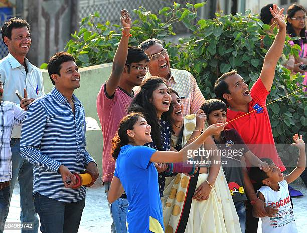 People enjoy kite flying on the eve of Makar Sankranti on January 14 2016 in Indore India The festival of harvest 'Makar Sankranti' is being...