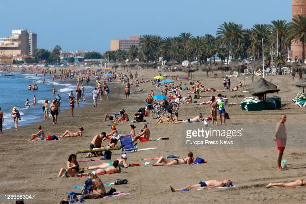 People enjoy La Malagueta beach during the first day of Phase 2 of deescalation due to Covid19 where bathing and sunbathing are already allowed all...