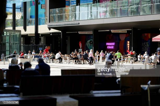 People enjoy lunch in Forrest Chase, Perth on May 18, 2020. COVID-19 restrictions have further eased across Western Australia in response to the...