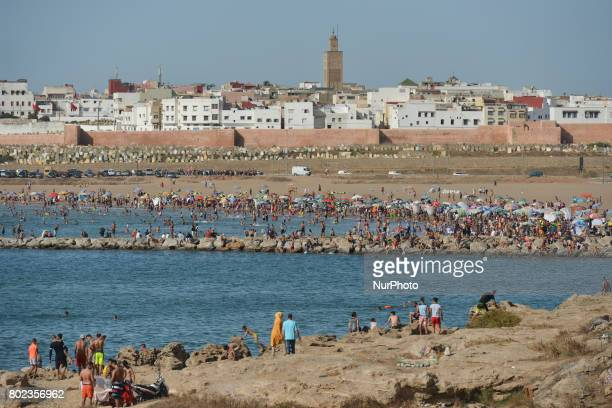 People enjoy nice weather during the final day of Eid alFitr holiday on Rabat beach seen from Kasbah of the Udayas fortress On Tuesday June 27 in...