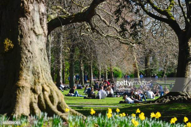 People enjoy nice weather in Dublin's Stephen Green as temperatures rise into the teens On Wednesday March 15 in Dublin Ireland