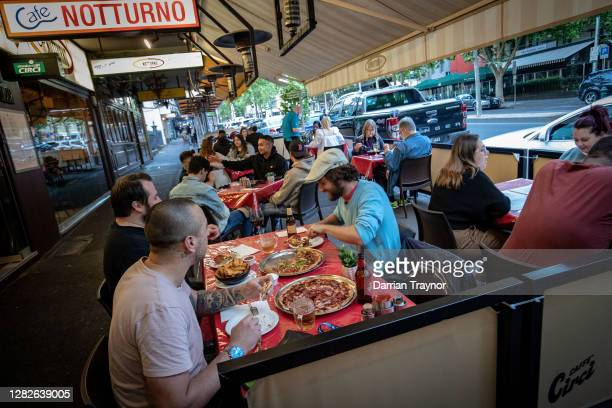 People enjoy outdoor eating on Lygon Street in Carlton on October 28, 2020 in Melbourne, Australia. Lockdown restrictions in Melbourne lifted as of...