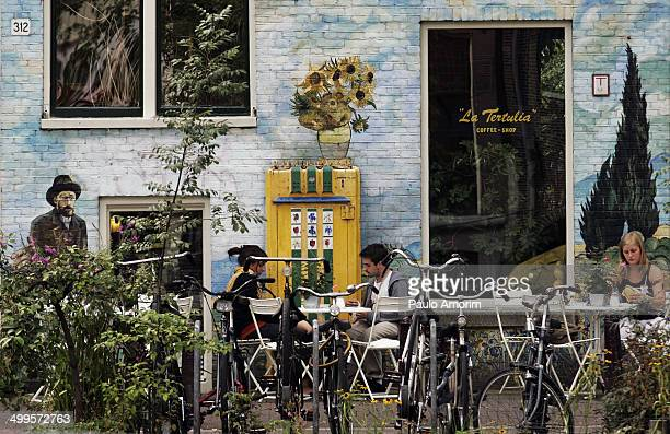 CONTENT] People enjoy outside of the coffee shop La Tertulia in Amsterdam
