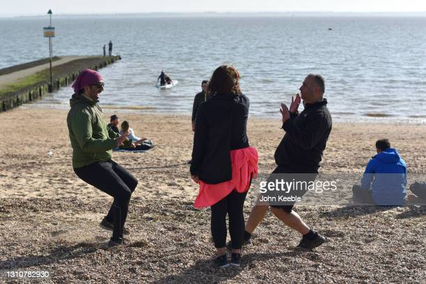 People enjoy playing games on a warm sunny Easter Sunday at Chalkwell beach on April 04, 2021 in Southend-on-Sea, England. Earlier this week, the UK...