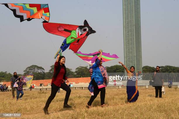 People enjoy playing their kites in the skies during the 'Kite Festival ' celebration at the Suhrawardy Udyan Park in Dhaka Bangladesh January 11...