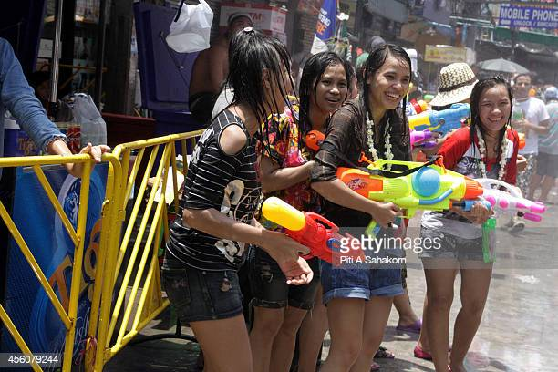 People enjoy playing with water guns to celebrate the water festival which marks the country's new year at Khaosan road in Bangkok Songkran is the...