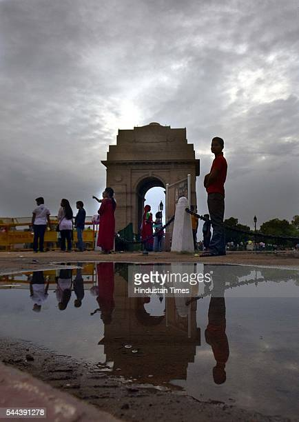 People enjoy pleasant weather after the premonsoon shower at India Gate on July 2 2016 in New Delhi India On Saturday the maximum temperature was...