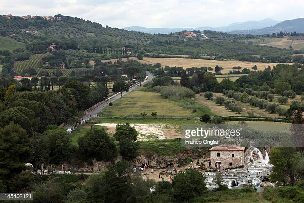 People enjoy Saturnia's Thermal Baths located south of Tuscany in the area known as Maremma on May 28 2012 in Grosseto Italy Use of the thermal baths...
