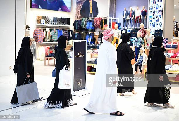 People enjoy shopping ahead of Eid celebrations on September 9 2016 in Dubai United Arab Emirates Muslims across the world are preparing to celebrate...