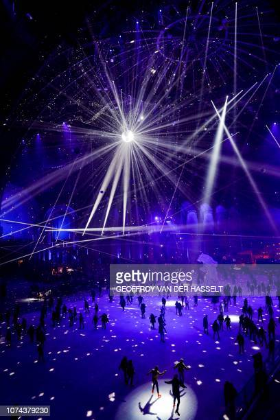 People enjoy skating on the ice rink under the glass dome of the Grand Palais in Paris, on December 18, 2018. - The Grand Palais skating rink opens...