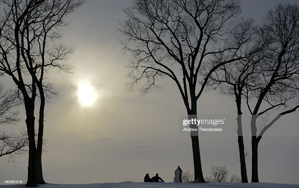 People enjoy sledding at St. John's Golf Course in heavy snow on January 27, 2015 in Setauket, New York. Snow levels from winter storm Juno in New York have ranged from 7.8 inches in Central Park to more than 28 inches in Eastern Long Island.