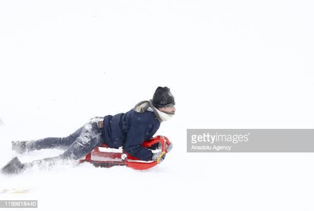People enjoy snow at Elmadag Ski Resort after snowfall in Ankara Turkey on February 9 2020