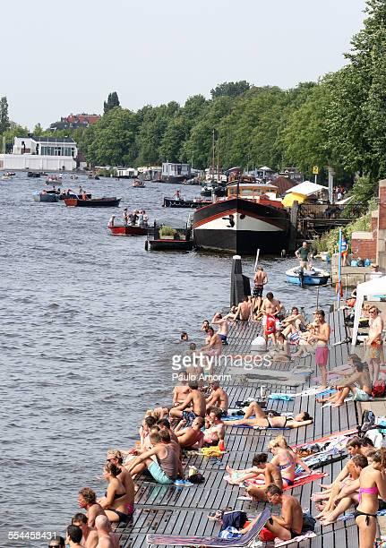 People enjoy summer in Amsterdam