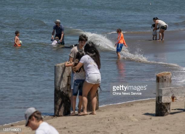 People enjoy sunshine at a beach near the Golden Gate Bridge amid the coronavirus outbreak on May 25, 2020 in San Francisco, California. The...