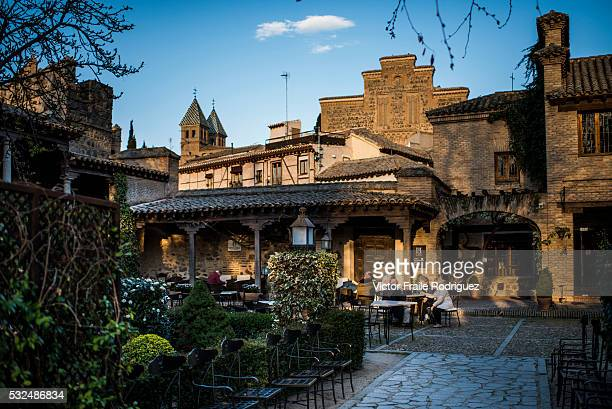 People enjoy tapas in a patio of Toledo on April 5, 2012 in central Spain. The city was declared a World Heritage Site by UNESCO in 1986 for its...