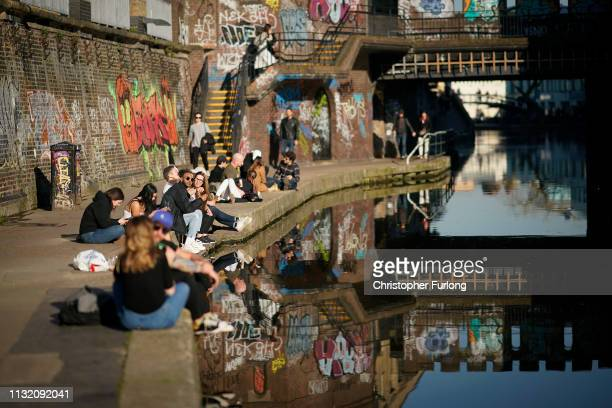 People enjoy the afternoon sunshine in alongside Regent's Canal at Camden Lock on February 25, 2019 in London, England. The UK has been experiencing...