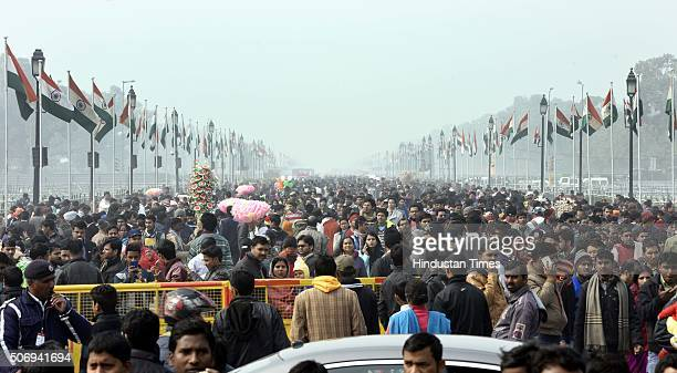 People enjoy the ambience after the end of the Republic Day Parade at Rajpath and India Gate on January 26 2016 in New Delhi India French President...