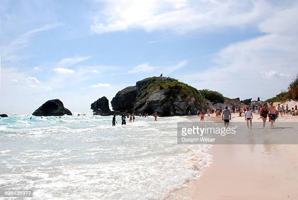 People enjoy the Atlantic Ocean on the beach of St George Bermuda