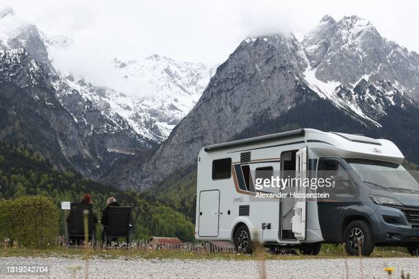 """People enjoy the atmosphere at motorhome campsite """"Camping Resort Zuspitze"""" in front of Germany's highest peak """"Zugspitze"""" on the first day of the..."""