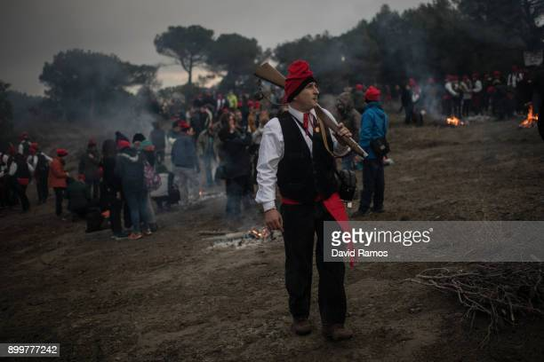 People enjoy the atmosphere during 'la Festa del Pi' on December 30 2017 in Centelles Spain Early in the morning men and women born in Centelles who...