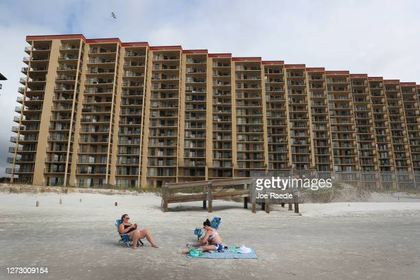 People enjoy the beach a day after Hurricane Sally passed through the area on September 17 2020 in Orange Beach Alabama The power in their apartments...