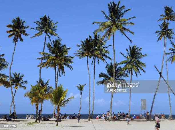 People enjoy the beach at Maracas Bay in Trinidad and Tobago on March 19 2008 AFP PHOTO/Yuri CORTEZ