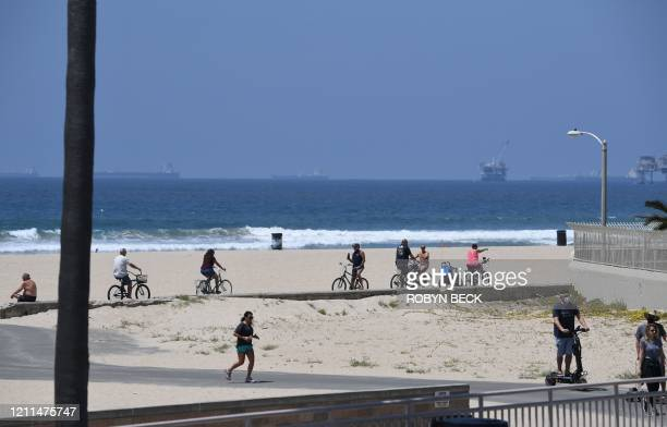 People enjoy the beach despite the state's stayathome order amid the coronavirus pandemic on May 1 2020 in California Beaches in some parts of...
