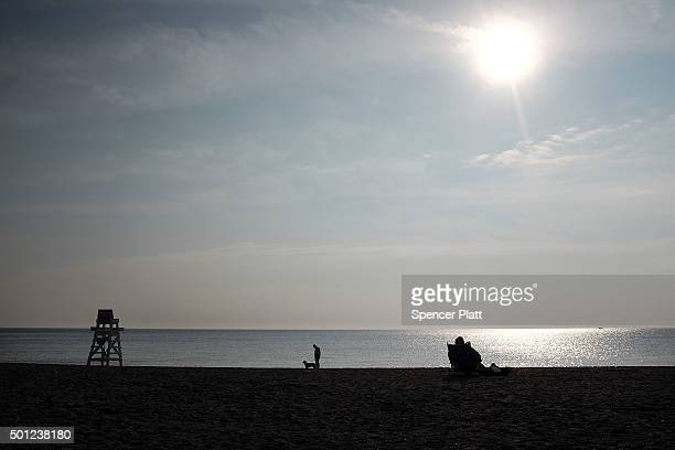 People enjoy the beach during an afternoon of warm and sunny weather on December 13 2015 in Fairfield Connecticut Temperatures across much of the New...