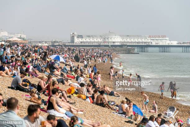 People enjoy the beach during the warm weather on Bank Holiday Easter Monday on April 22 2019 in Brighton England This Easter weekend has broken...