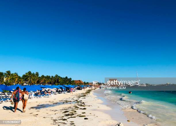People enjoy the beach in Isla Mujeres Quintana Roo State Mexico on February 16 2019