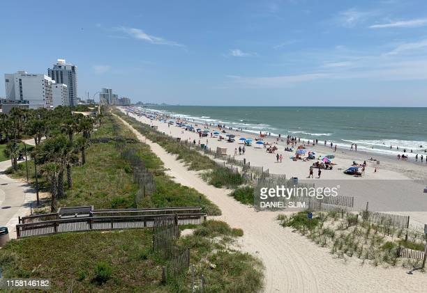 People enjoy the beach in Myrtle Beach South Carolina on July 27 2019
