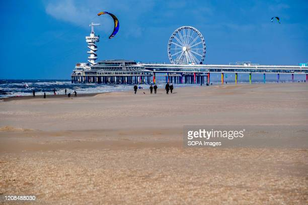 People enjoy the beach in schevingen despite the advice of staying at home as a preventive measure against the coronavirus crisis.