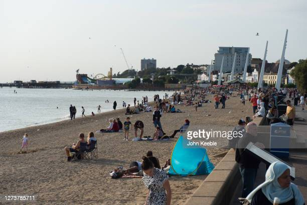 People enjoy the beach in the late afternoon during the recent warm weather on September 20, 2020 in Southend on Sea, London.
