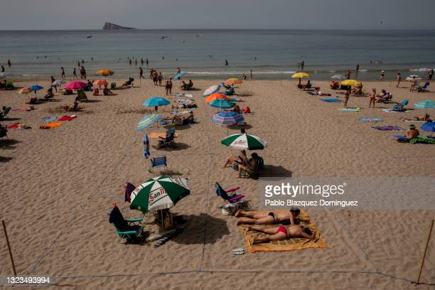 People enjoy the beach observing social distancing on June 14, 2021 in Benidorm, Spain. Spain's immunisation drive, which has fully vaccinated more...